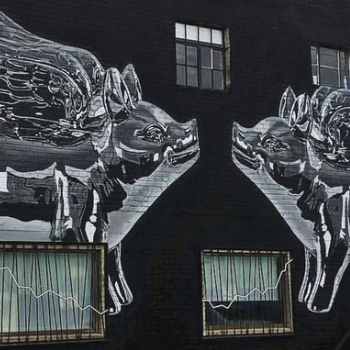 Photo of a large mural of two kissing metallic pigs with wings on a dark background.
