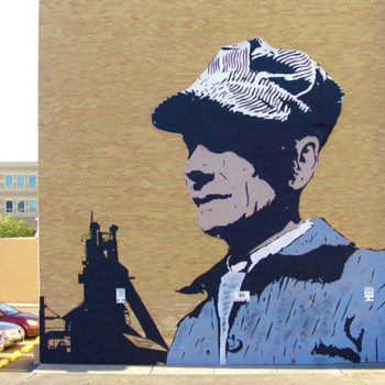 Photo of a graphic mural of a bust of vintage train engineeer.