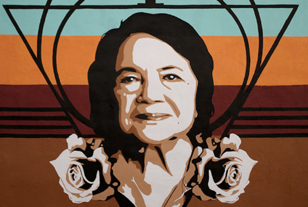 Mural of an older hispanic woman's portrait with roses.