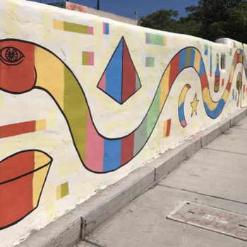 Abstract mural of a snake created from shapes.