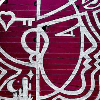 Simple line mural of a woman's head with a heart in it in only two colors. like a rose
