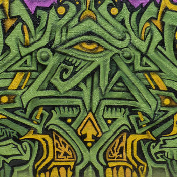 Mural that is green like grass or money that looks like a symbol of the illuninati's all seeing eye.