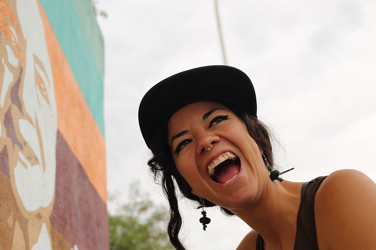 Photo of the artist, very happy lady with a nose piercing.