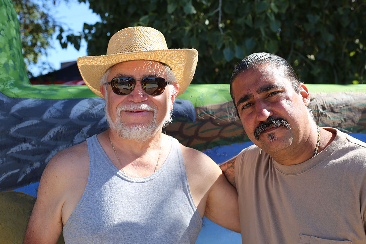 Photo of two New Mexican men. The artists.
