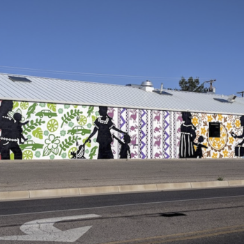 mural of shadow figures on colorful wall paper