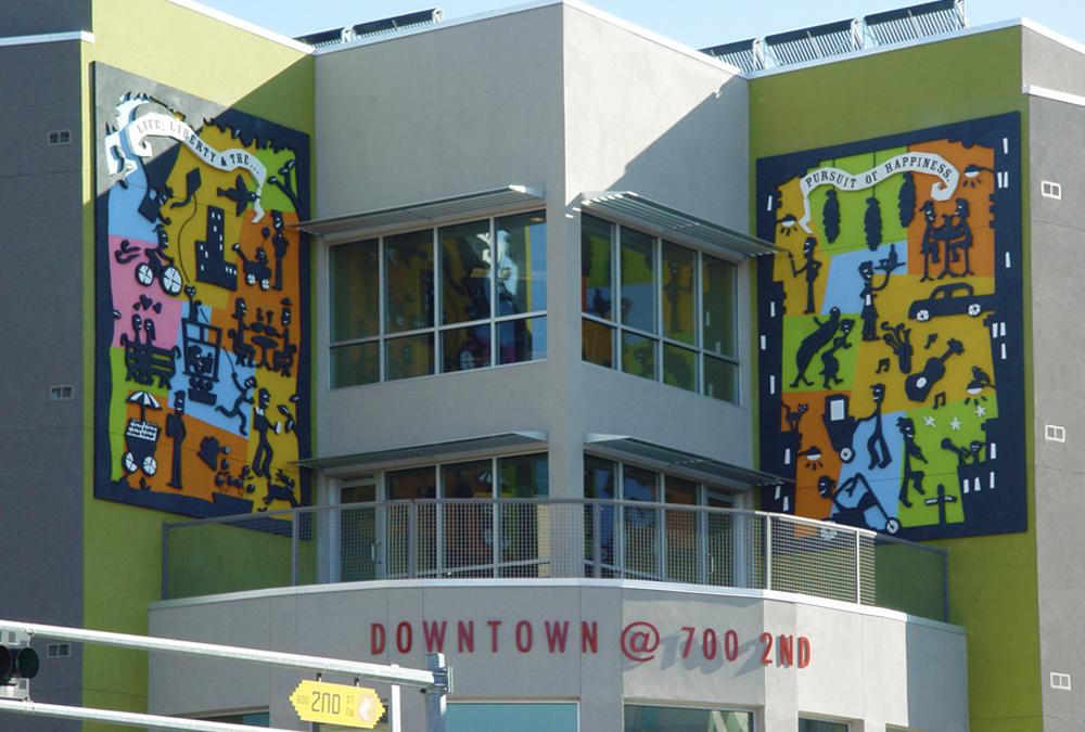 stick figure art murals on wall downtown