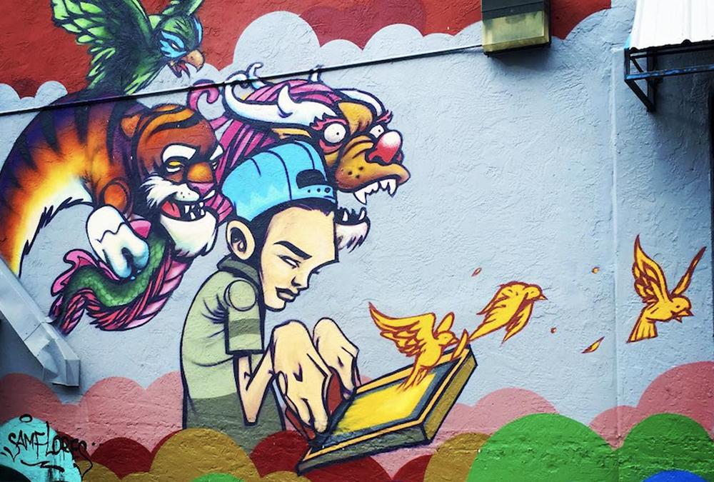 mural of cartoon boy good vs evil