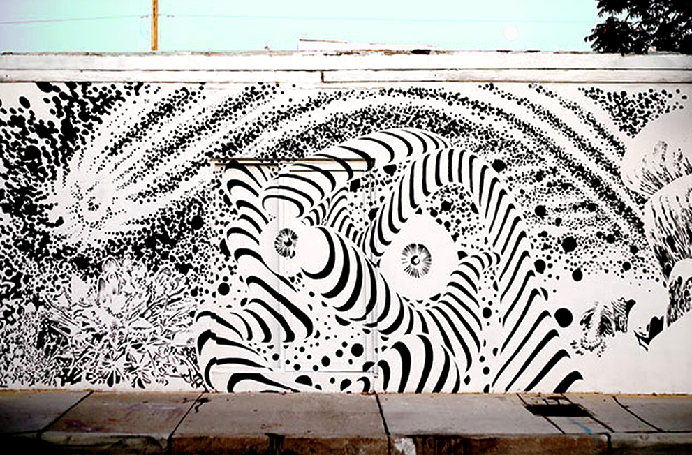 A trippy mural in just black and white of and abstracted universe. Kind of 70's inspired or like a black and white comic style.