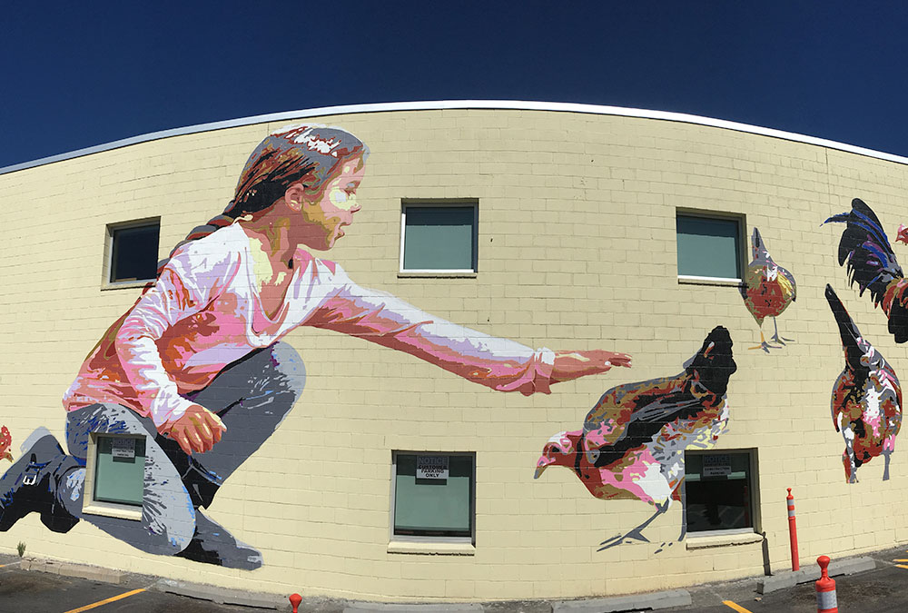 mural of girl petting chicken