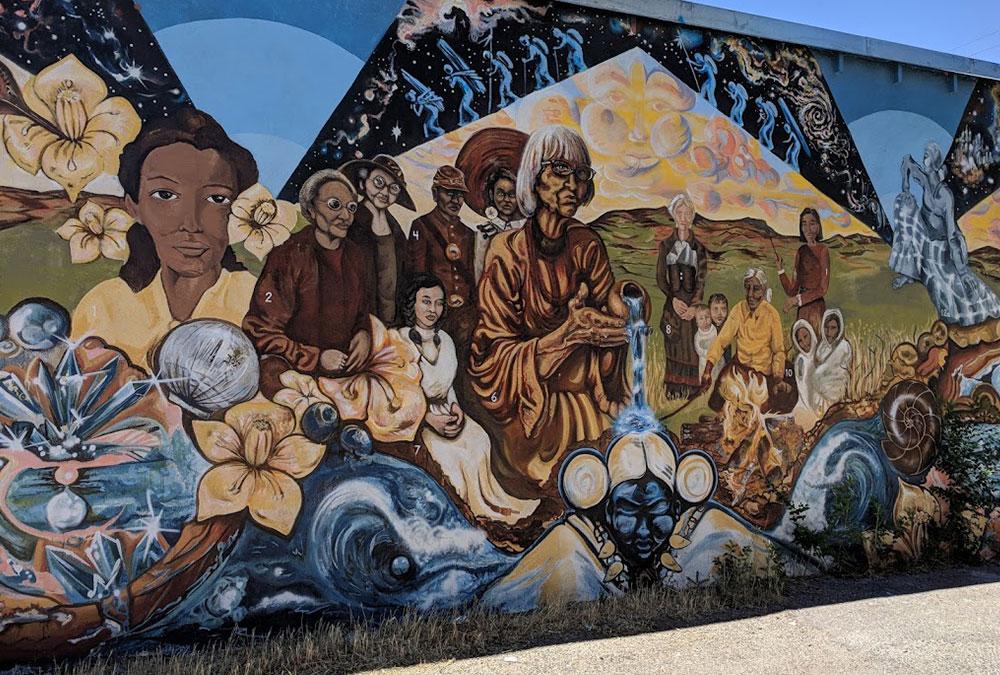 mural of female spirits in offering
