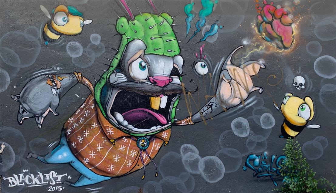 cartoon animal in cactus costume mural