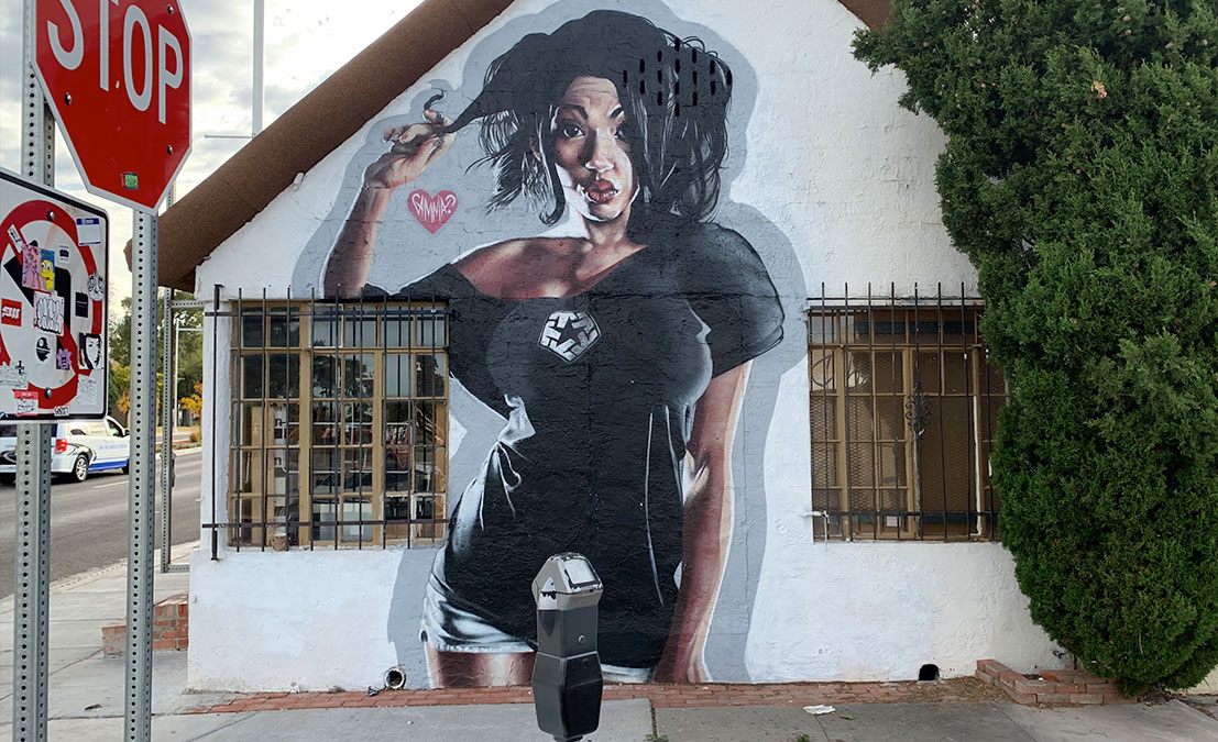 mural on house of sassy lady twirling hair