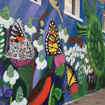 scene of flora and fauna mural on wall