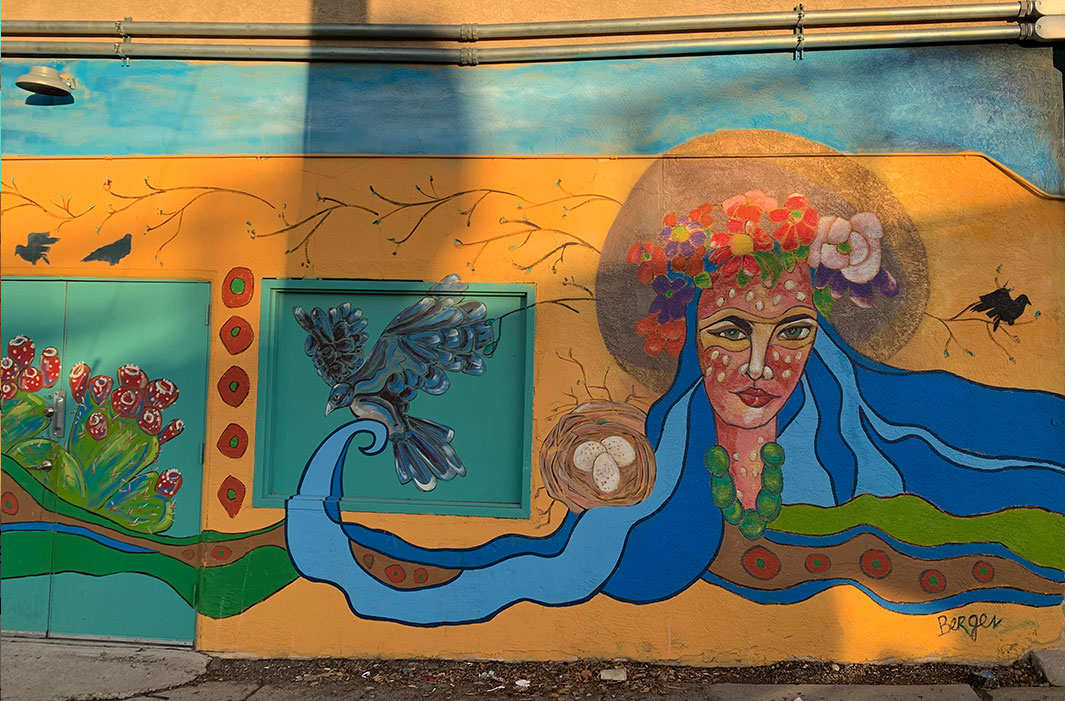 mural of woman with flowing hair and bird with nest