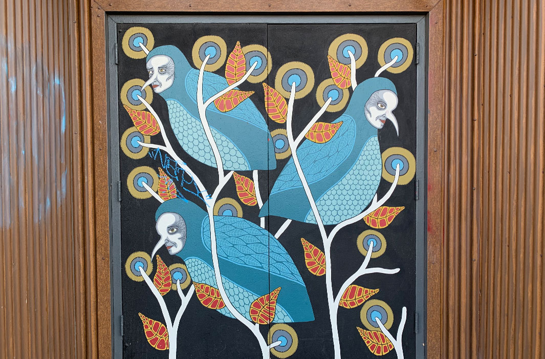 mural of masked birdmen