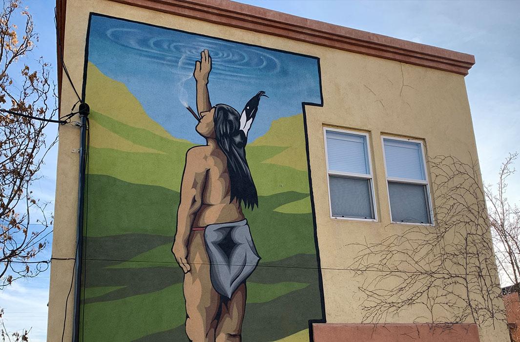 mural of smoking Indian salute