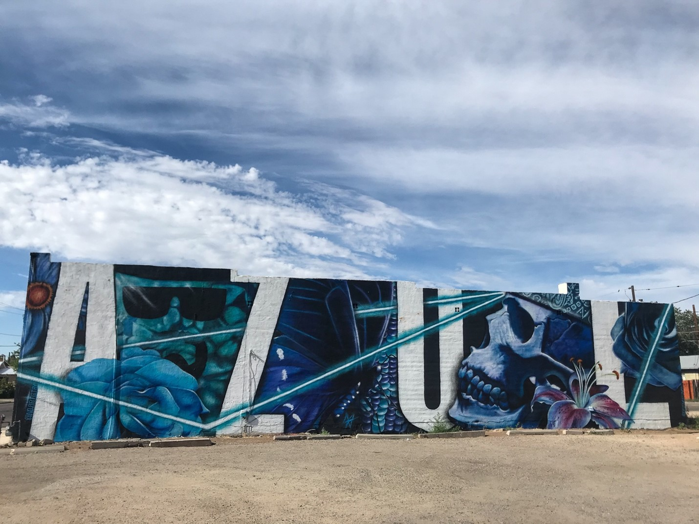 Large white letters spelling AZUL amidst blue imagery